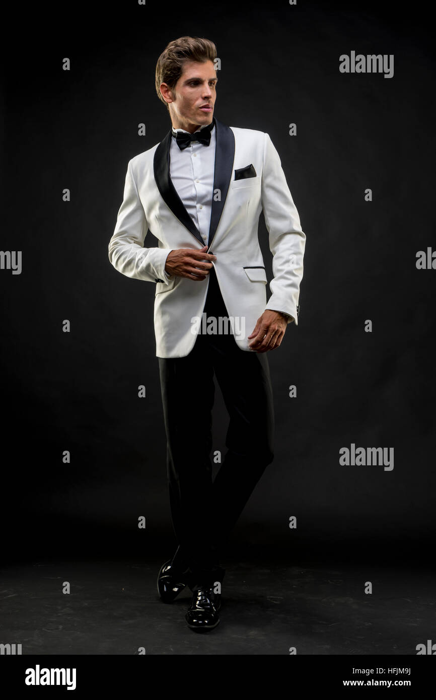 elegant and handsome man dressed in tuxedo for new year s eve or