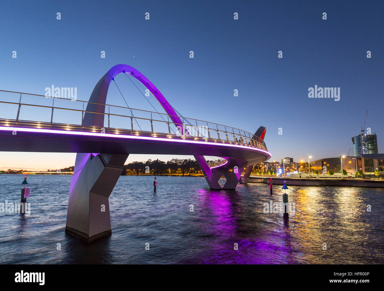 The Elizabeth Quay bridge on the Swan River illuminated at twilight, Perth, Western Australia, Australia - Stock Image