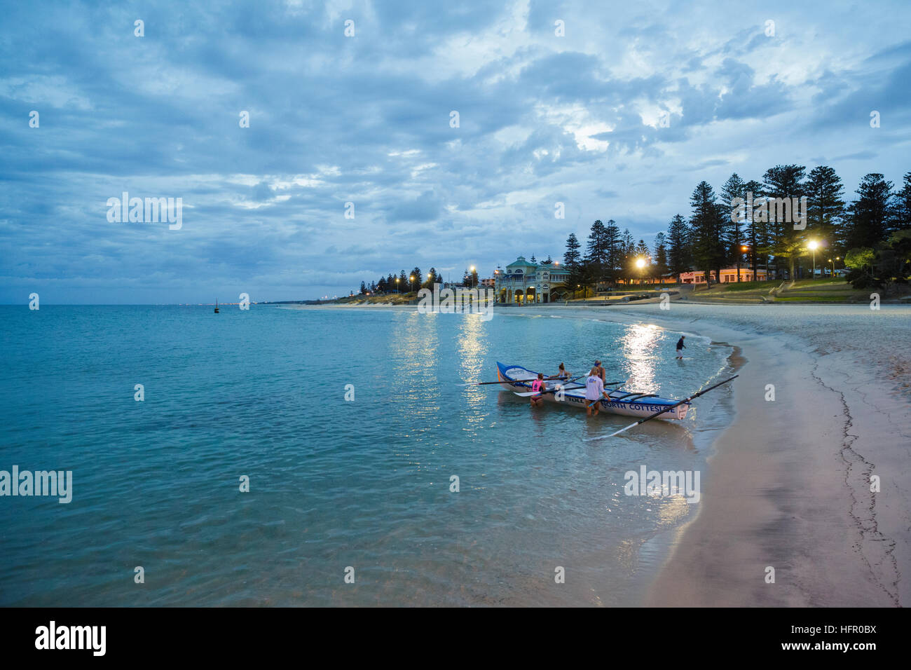 Female North Cottesloe Surf Life Saving Club members training in a long boat at dawn. Cottesloe, Perth, Western - Stock Image