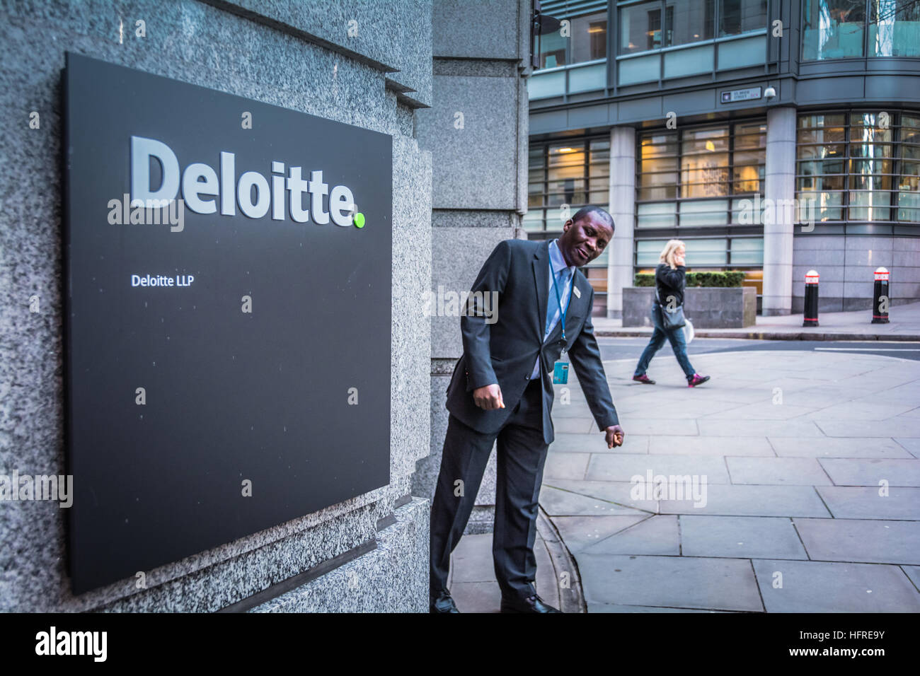 A security guard outside Deloitte's headquarters campus on Stonecutter Court, London, UK Stock Photo