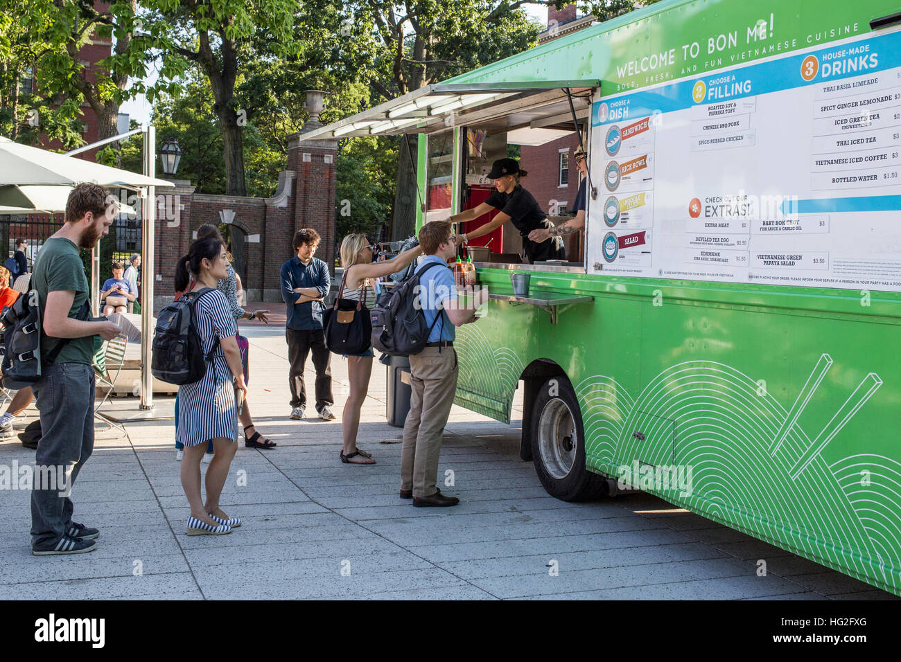 People buying food at a food truck in Harvard Square, Cambridge, MA - Stock Image