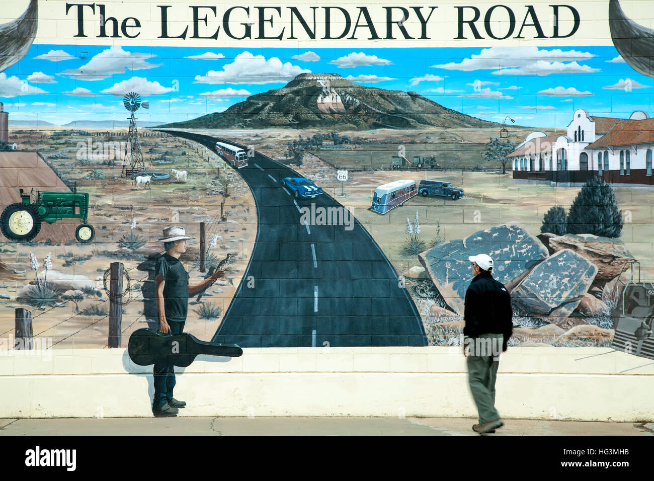 Man and Route 66 mural (by Doug and Sharon Quarles), Route 66, Tucumcari, New Mexico USA - Stock Image