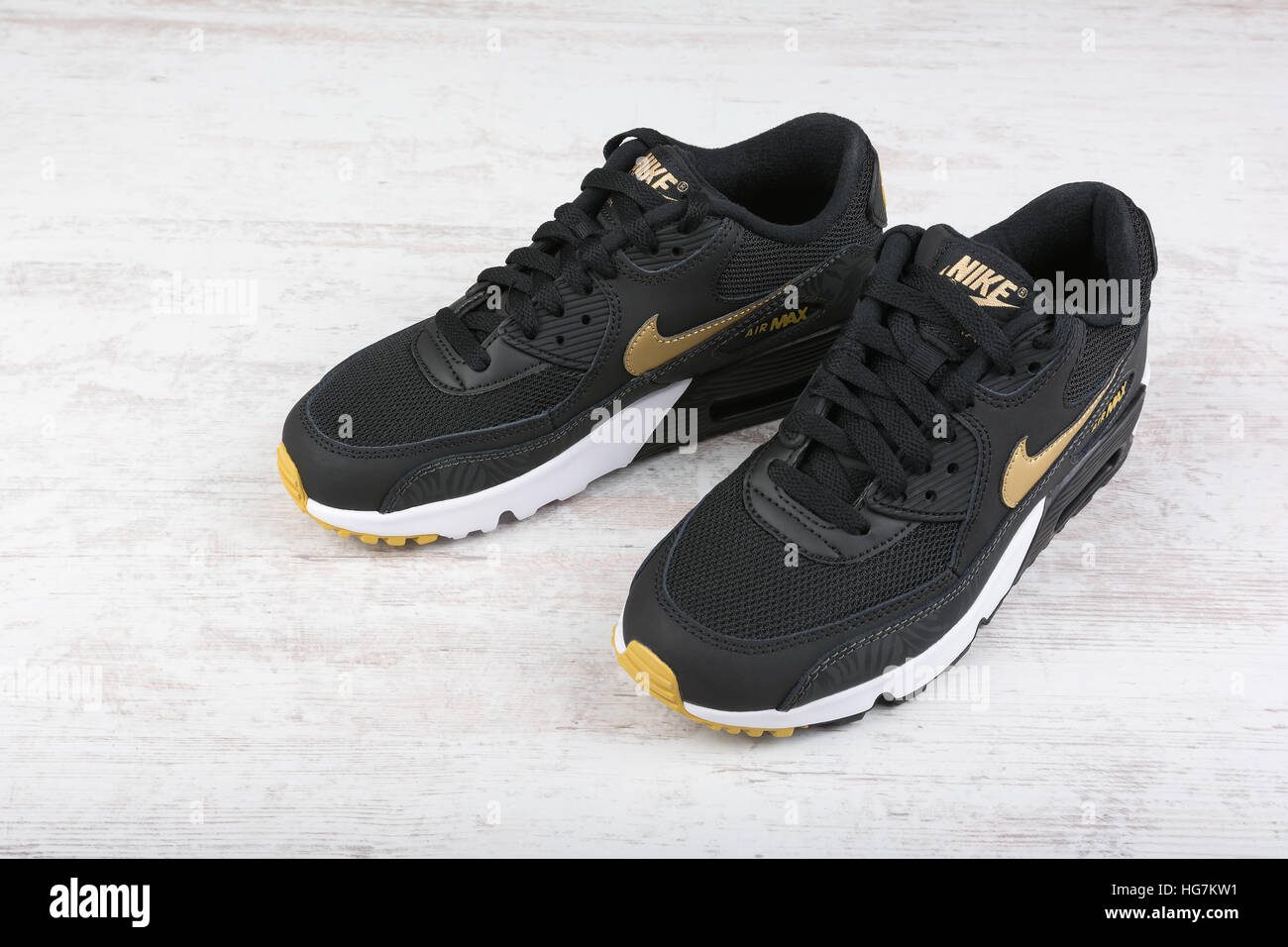 BURGAS, BULGARIA - DECEMBER 29, 2016: Nike Air MAX women's shoes - sneakers  in black, on white wooden background. Donka Zheleva / Alamy Stock Photo