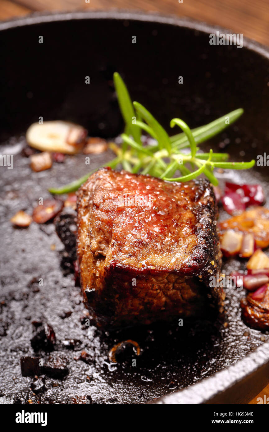 Beef steak on cast iron skillet - Stock Image