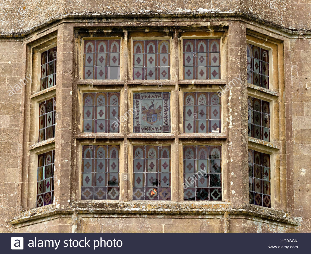 Tudor Leaded Stained Glass Bay Window, Newark Park House, Ozleworth,  Gloucestershire, England, UK