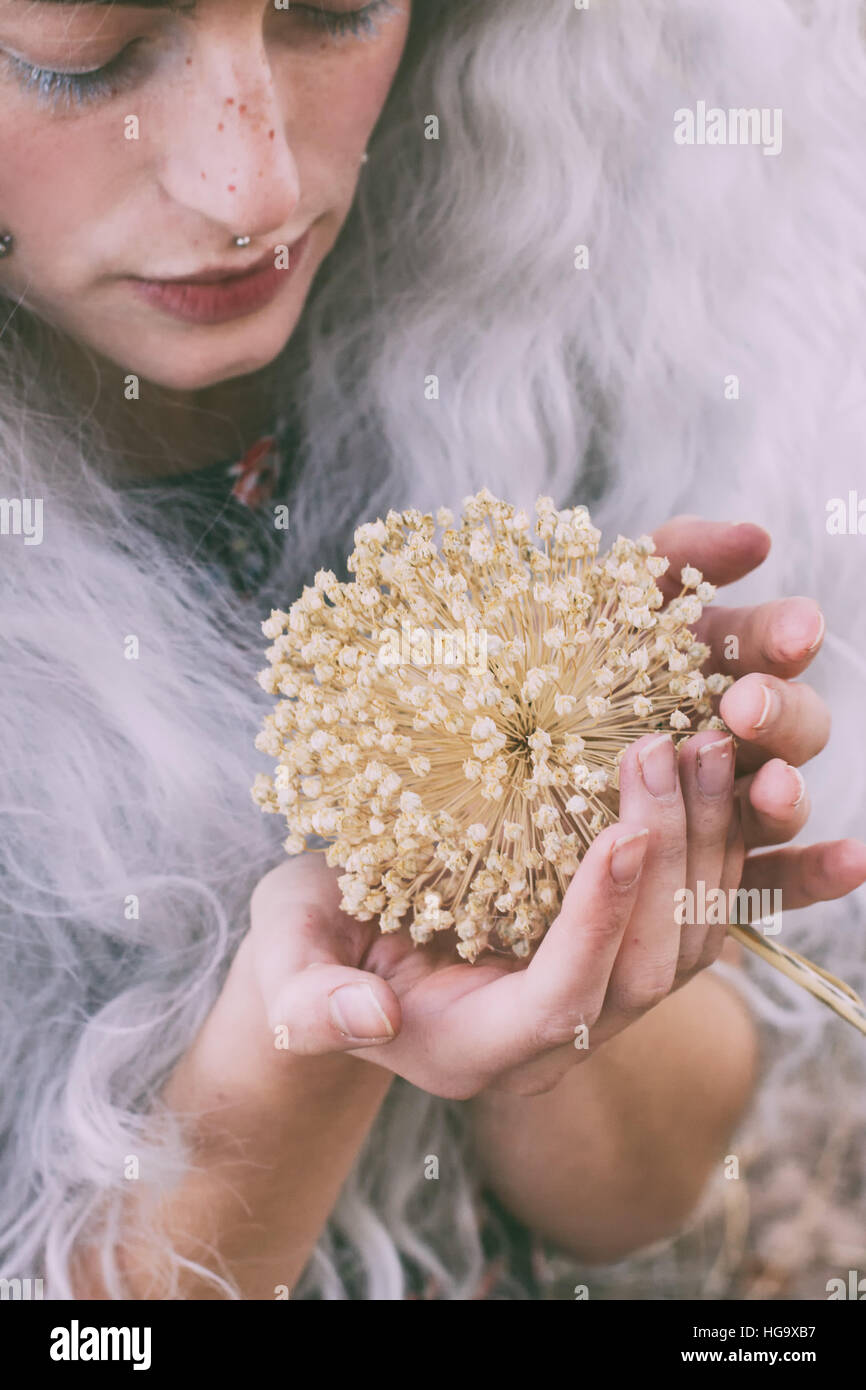 Young modern witch harvest weird plants - Stock Image