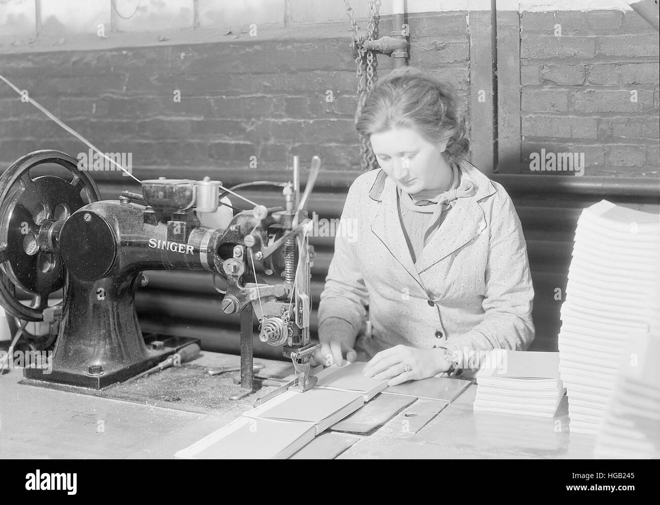 Woman side stitching books at the Kingsport Press, Tennessee, 1933. - Stock Image