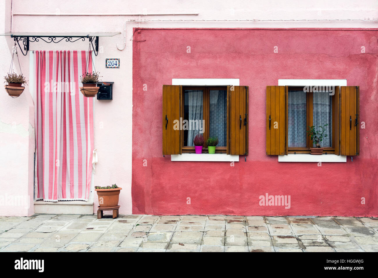 Pink house exterior in Burano, Venice, Italy Stock Photo: 130678424 ...