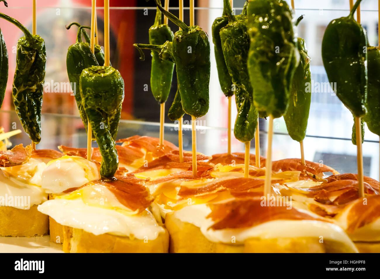tapas-on-display-in-glass-cases-on-spanish-bar-HGHPF8.jpg