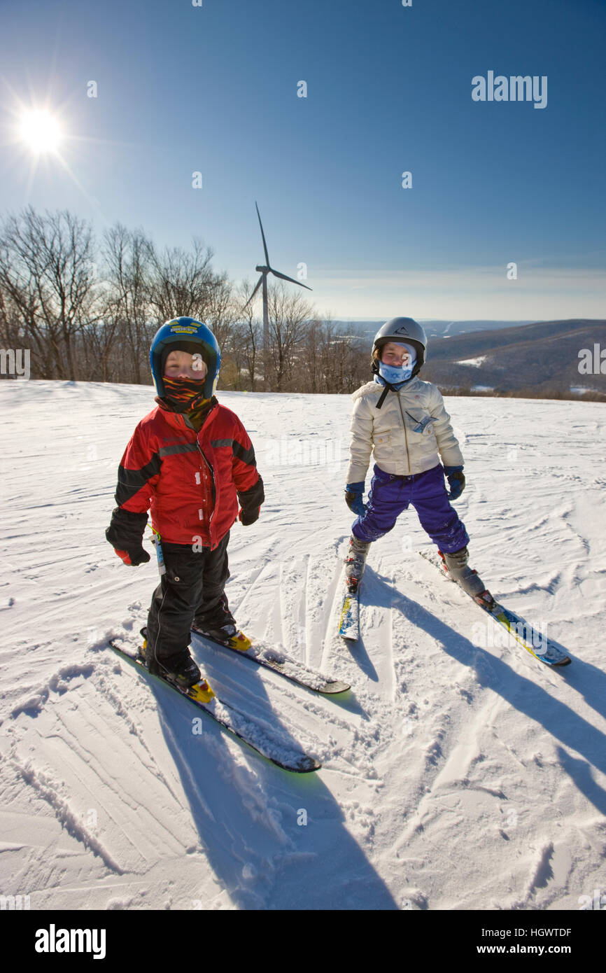 two young skiers at jiminy peak ski resort in the berkshire