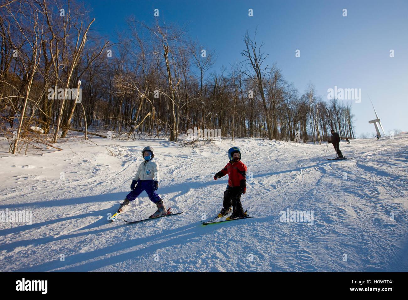 skiers at jiminy peak ski resort in the berkshire mountains in stock