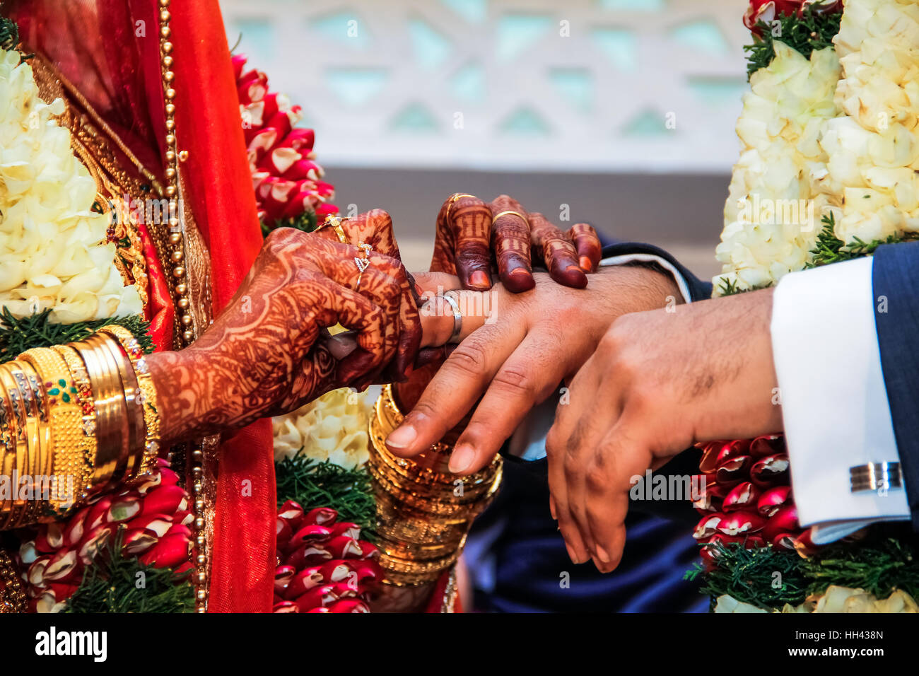 Bride Putting Wedding Ring On Groom S Finger At Traditional South