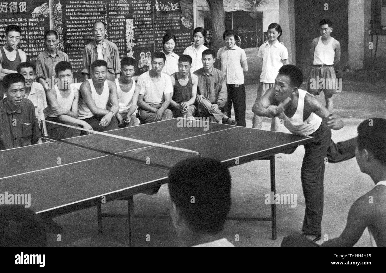 Workers playing and watching a game of table tennis during the Cultural Revolution era in Communist China. - Stock Image