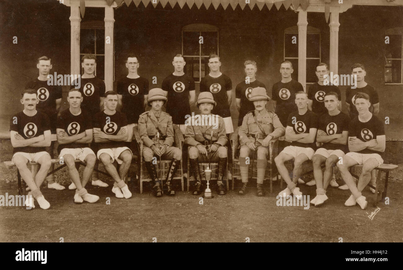 Group photo, British sports team, with officers and cup, Quetta, India (now in Pakistan). - Stock Image