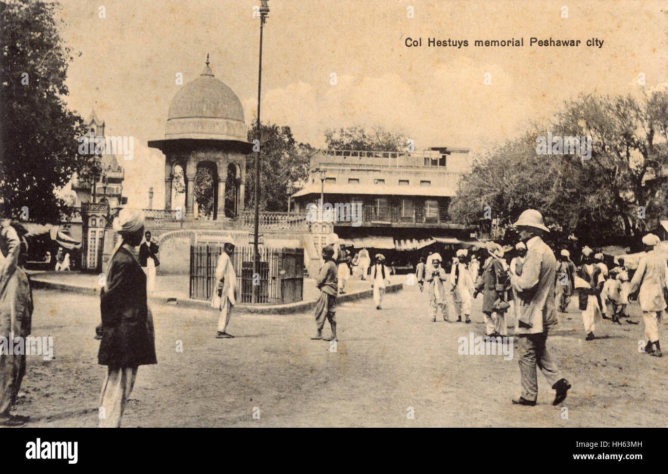 Memorial to Colonel E C Hastings (d.1884) and street scene, Peshawar City, British India (now in Pakistan, called - Stock Image