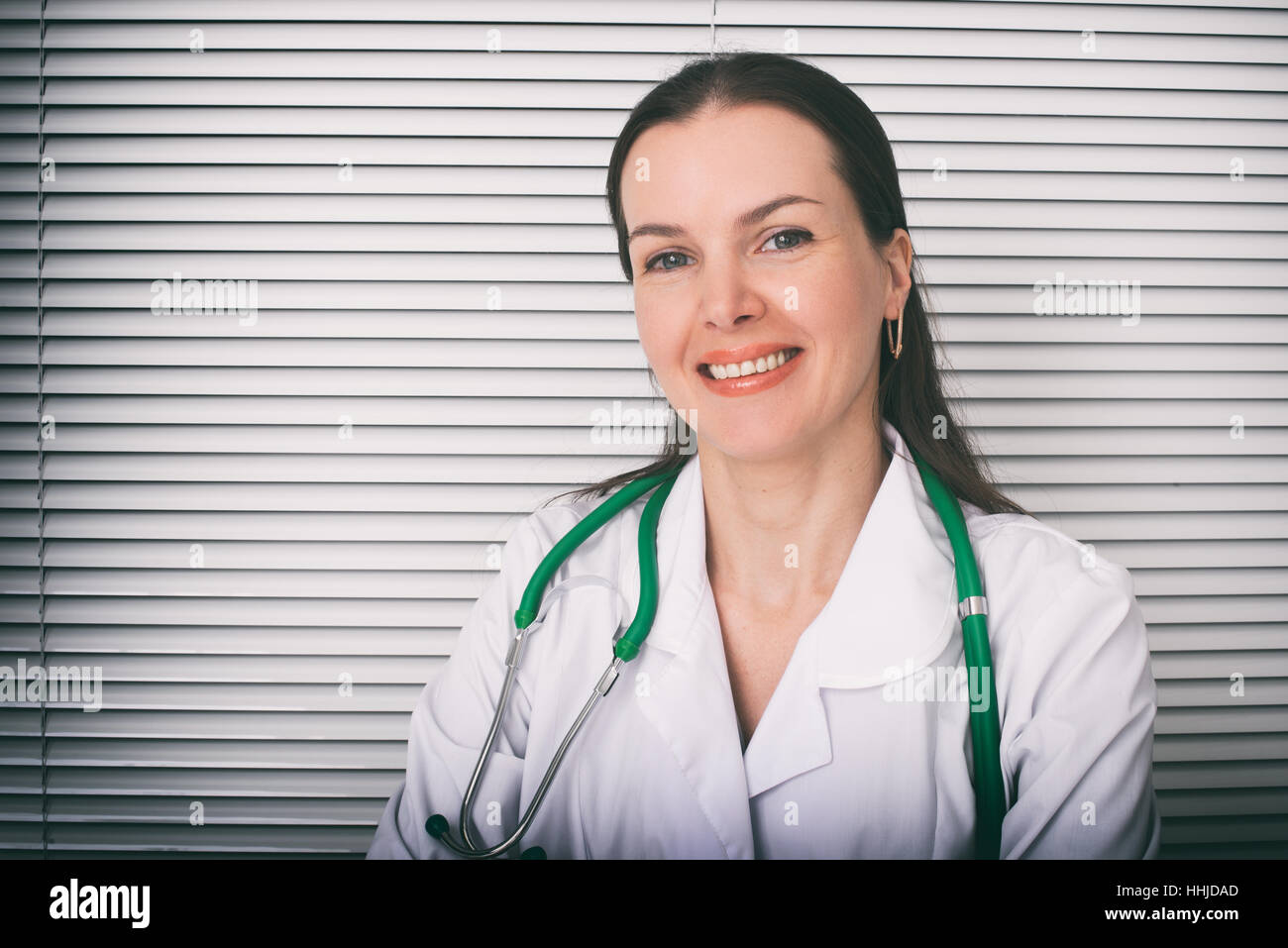 Portrait of Smiling female doctor in hospital - Stock Image