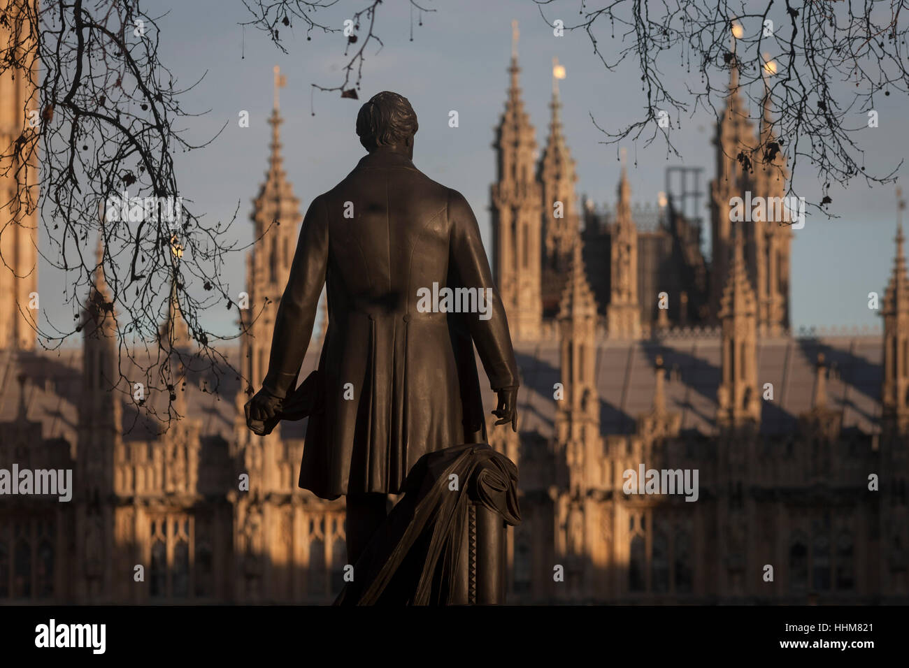The statue of Sir Robert Peel and the British Houses of Parliament, on 17th January 2017, in Parliament Square, Stock Photo