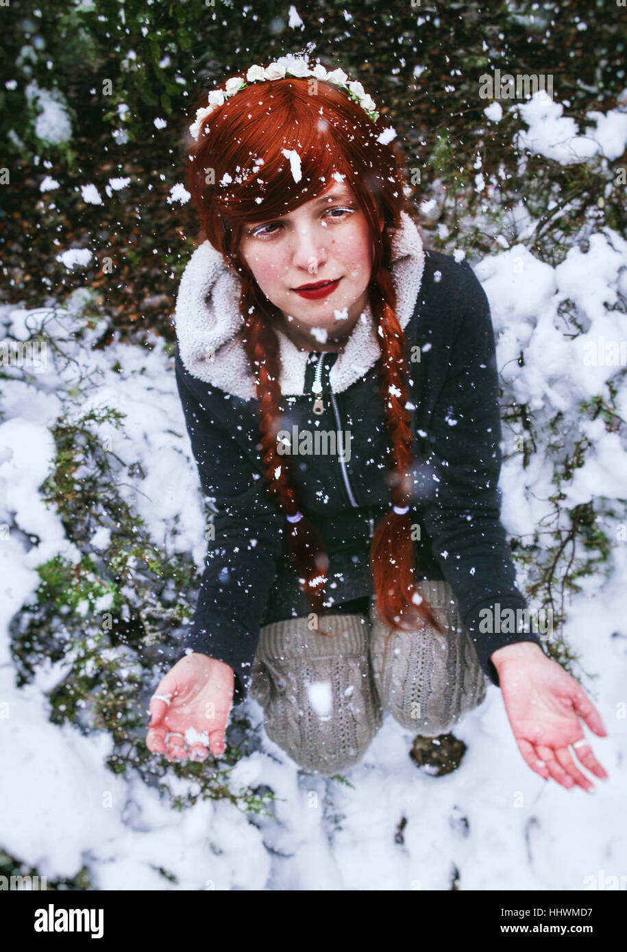 Young redhead woman at winter snowy day - Stock Image