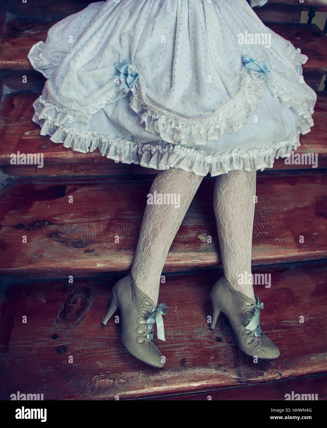 Woman leg's wearing vintage dress, tights and shoes - Stock Image