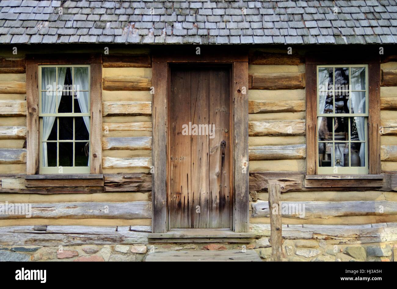Traditional Pioneer Log Cabin. Exterior Front Door And Wall Of Historical  1800s Style Pioneer Home.