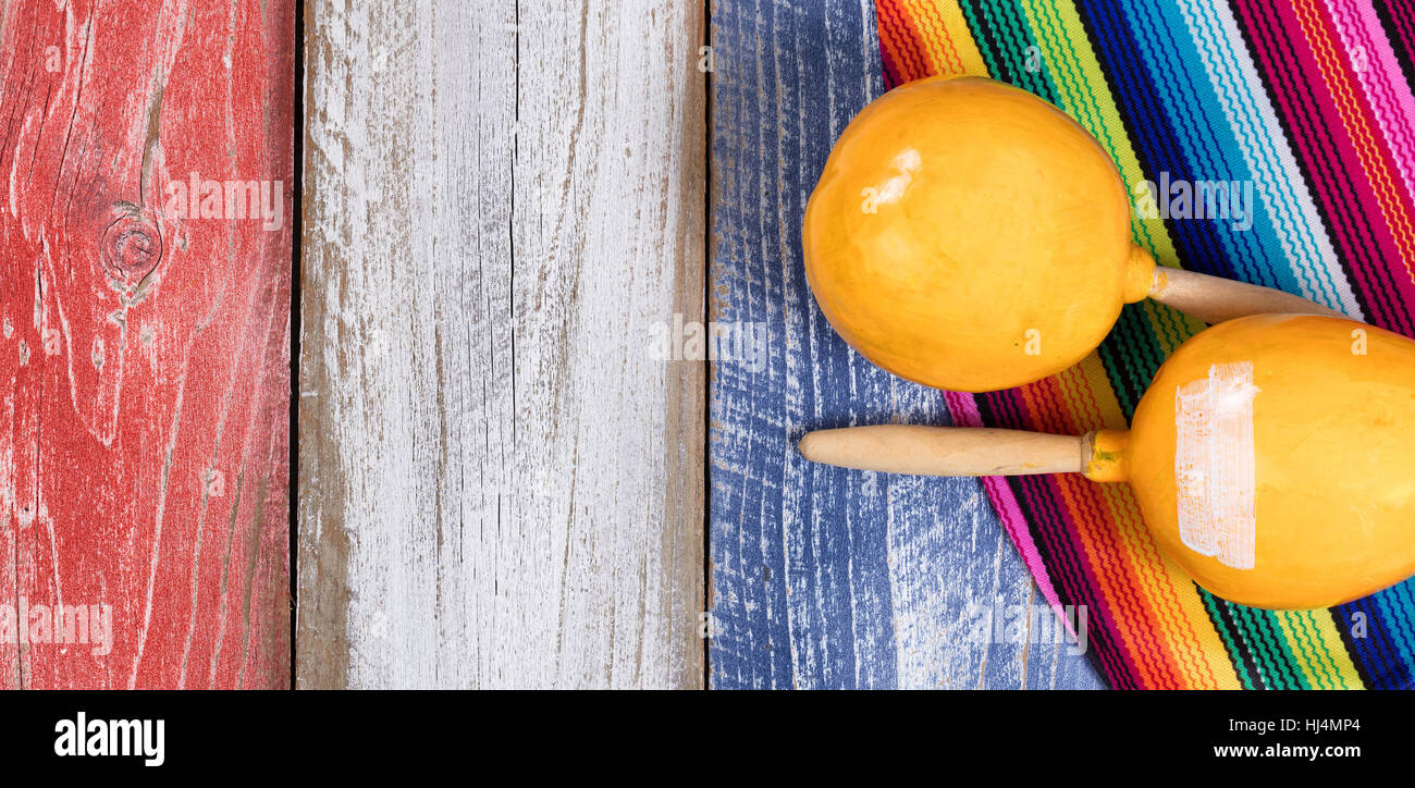 cinco de mayo holiday concept in usa with mexican maracas on rustic