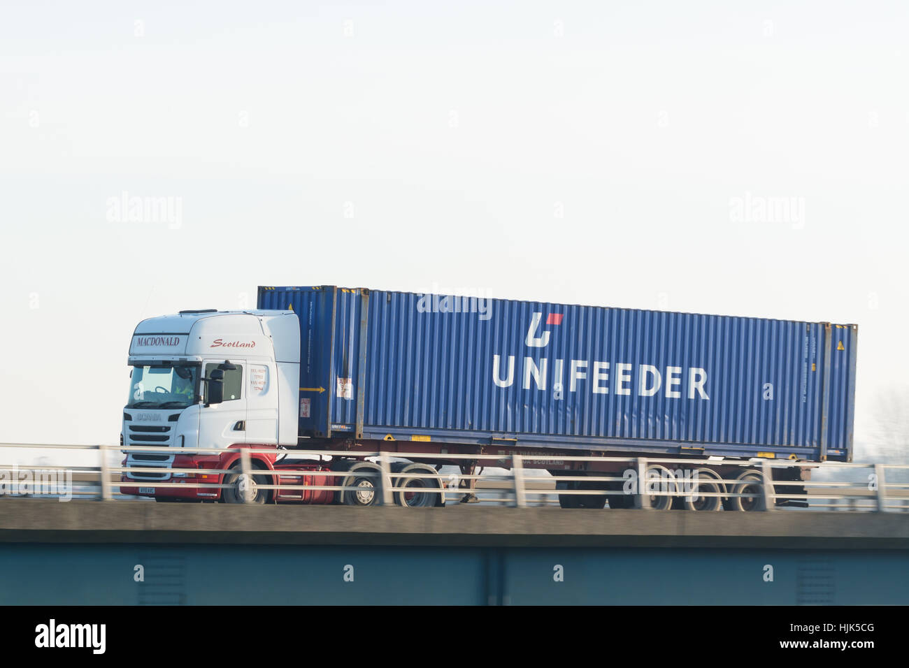 Unifeeder shipping container on lorry - Scotland, UK - Stock Image
