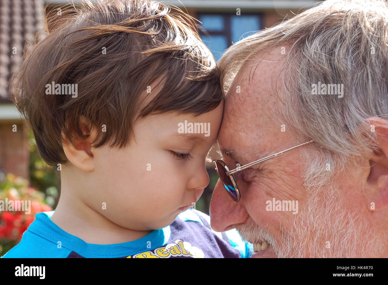a-grandfather-with-his-young-grandson-HK4R70.jpg