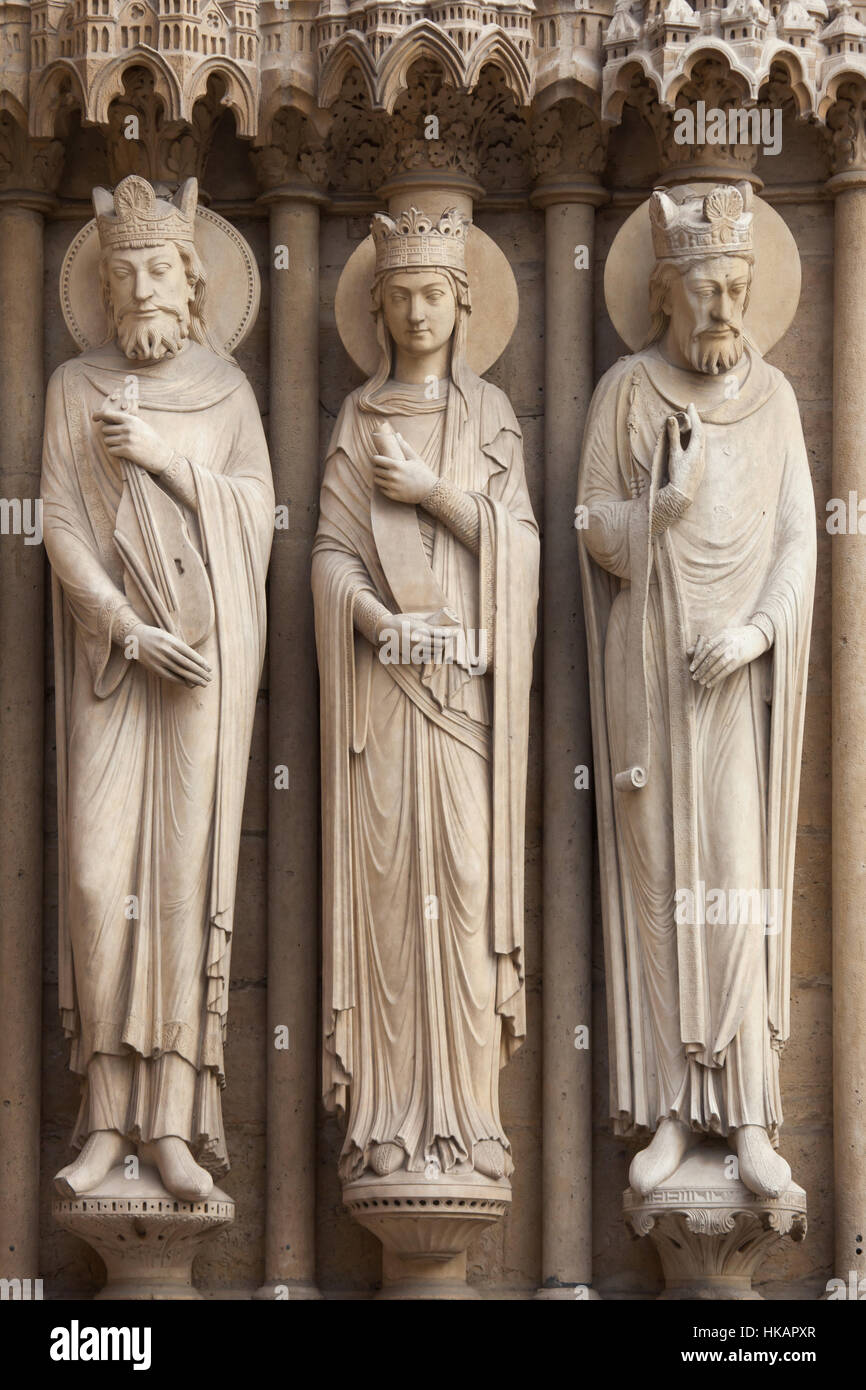 King David, Bathsheba and an unidentified king (from left to right). Neo-Gothic statues on the main facade of the Stock Photo