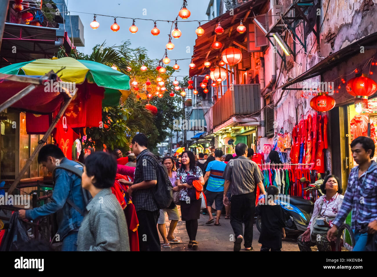 Crowd in a narrow street decorated with Chinese lanterns in Jakarta Chinatown. © Reynold Sumayku Stock Photo