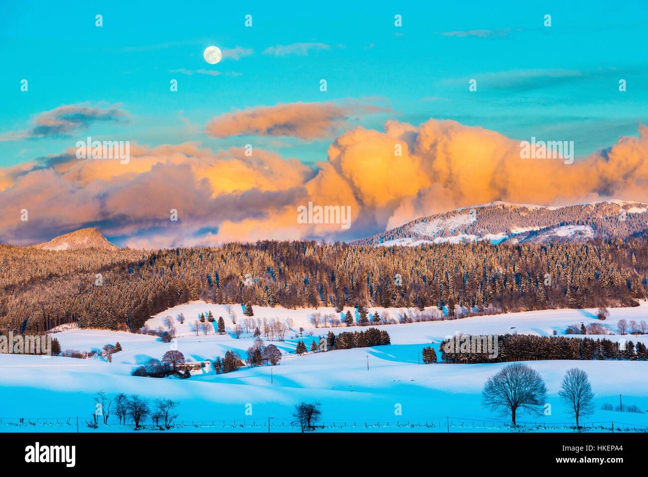 Sunset over the Métabief Valley (north-eastern France) in the Jura mountain range covered in snow. - Stock Image