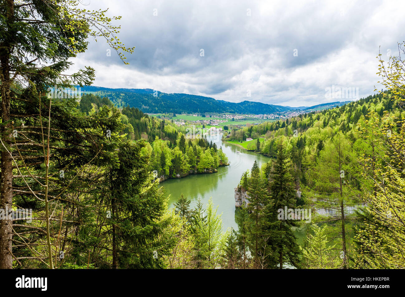 The Doubs River and Valley on the Swiss side, upstream from the Saut du Doubs Waterfall in the town of Les Brenets - Stock Image