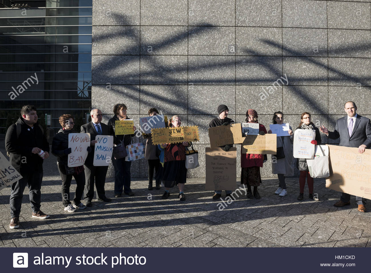 Tokyo, Japan. 31st Jan, 2017. People hold up placards to protest against US President Donald Trump's executive - Stock Image