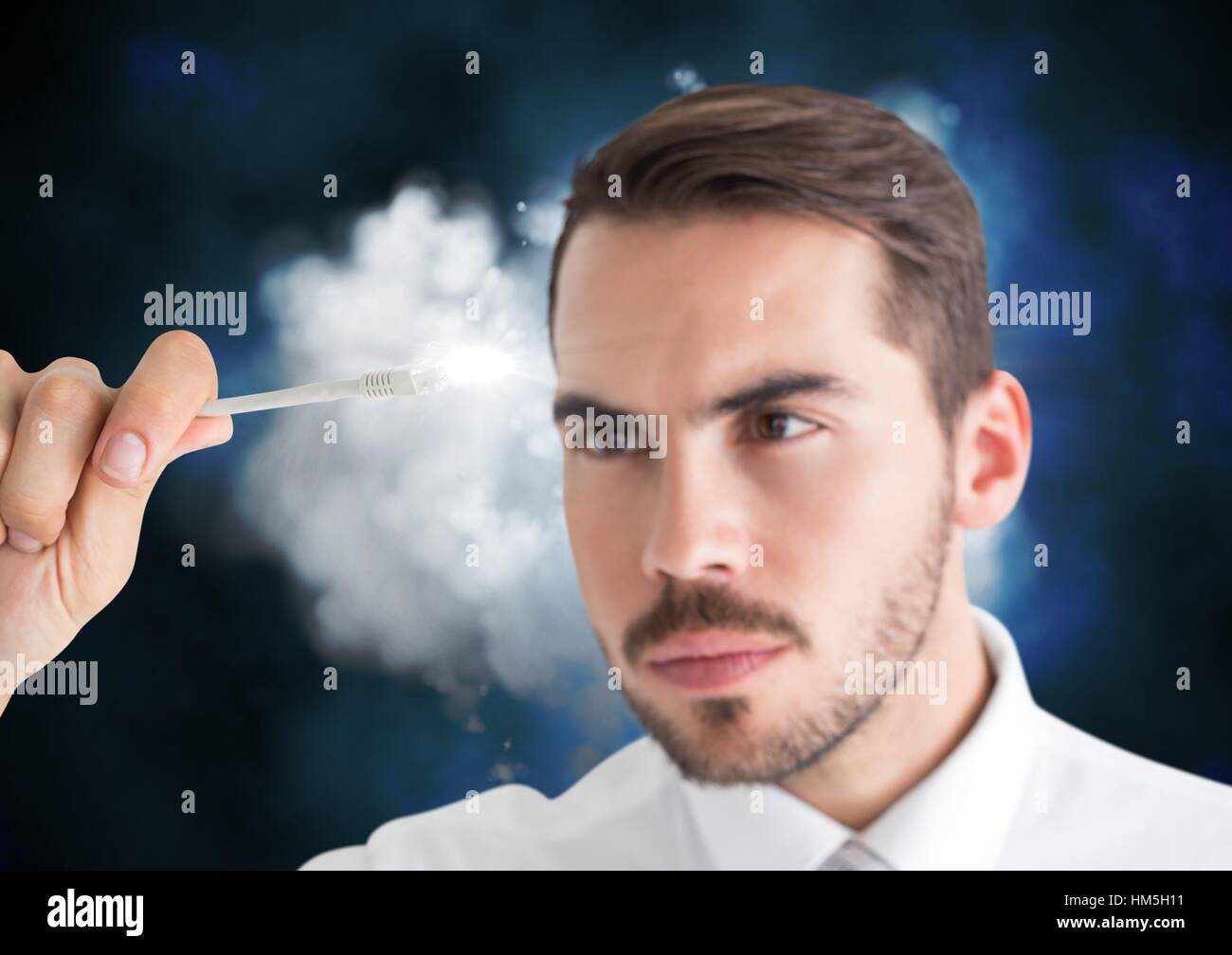 Man connecting cable to the cloud - Stock Image