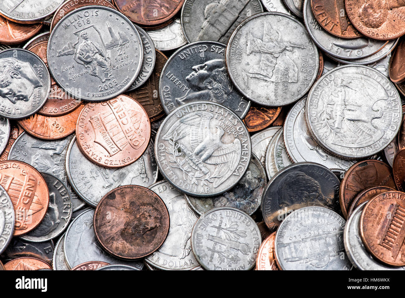 A pile of American currency coins, including quarters, dimes ...
