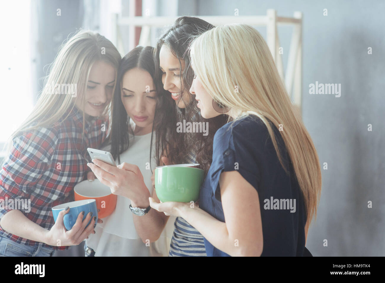 Group beautiful young people enjoying in conversation and drinking coffee, best friends girls together having fun, - Stock Image