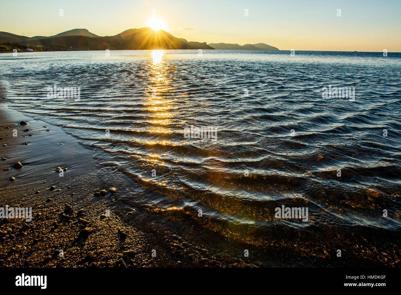 mystic sunrise of sea - Stock Image