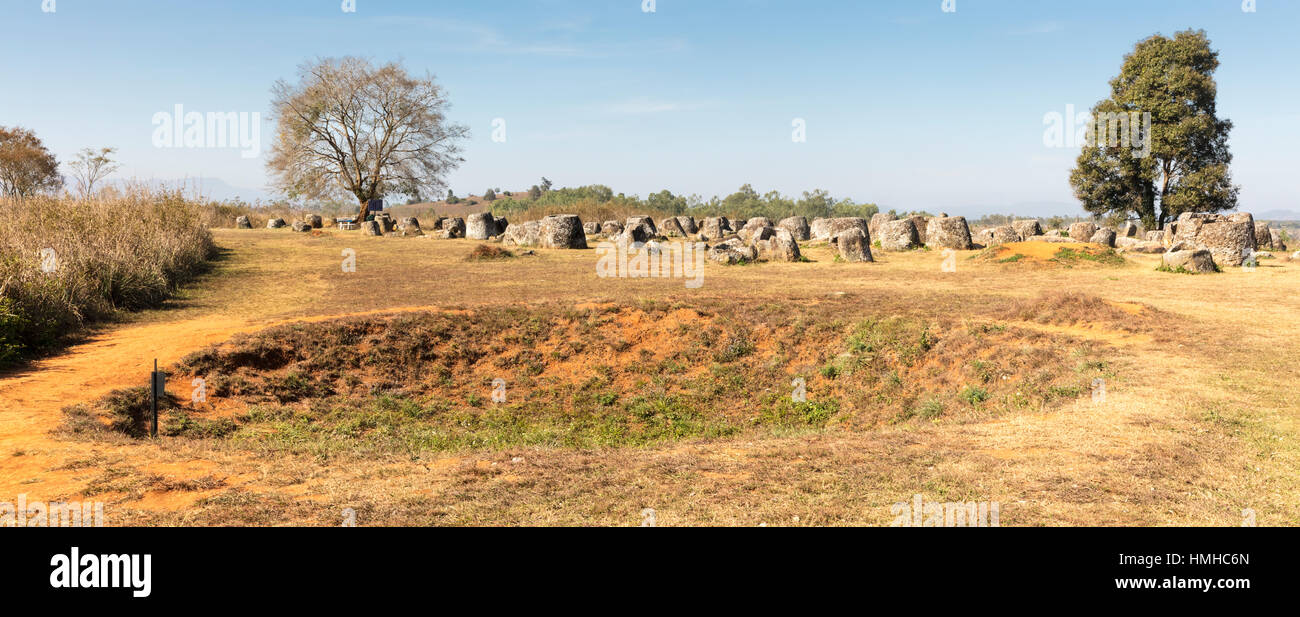 Ancient Stone Jars and Modern Bomb Crater  in the Plain of Jars, near Phonsevan, Xiang Khouang Province, Laos - Stock Image
