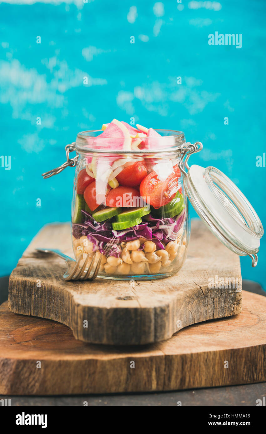Vegetable and chickpea sprout vegan salad in jar, copy cpace - Stock Image