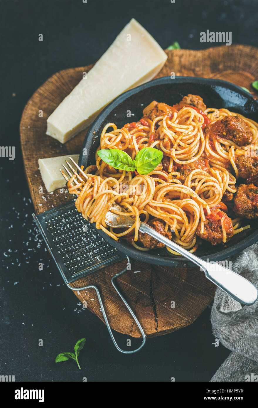 Italian dinner with meatballas, basil and parmesan cheese pasta - Stock Image
