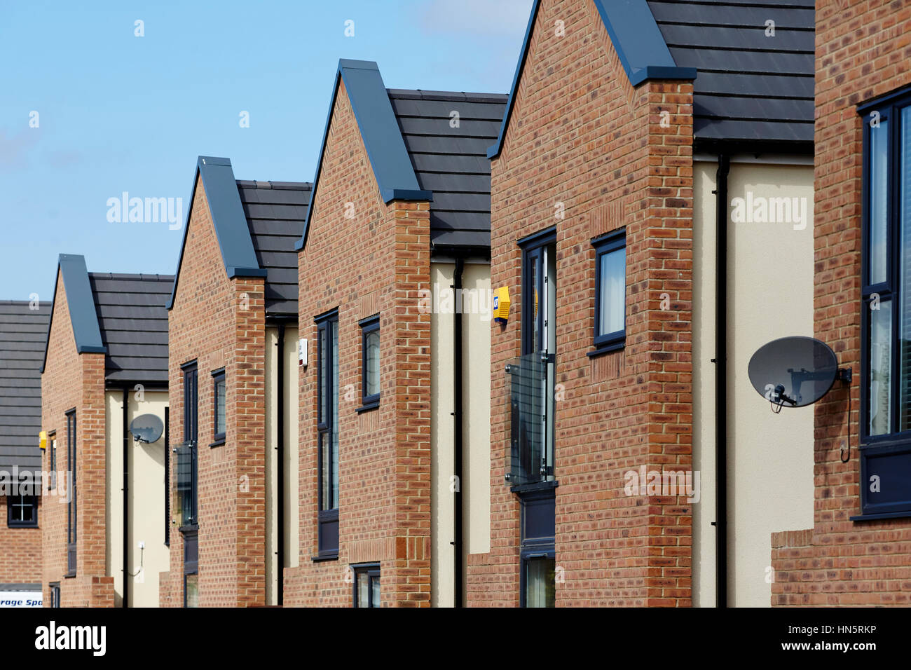 Sunny day close up of modern design new build Barratt brick housing estate development site, in England UK Stock Photo