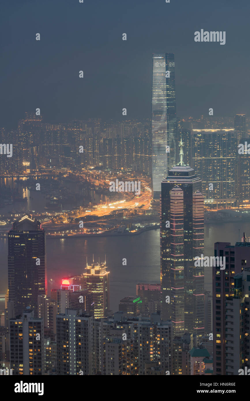 View over Hong Kong from Victoria Peak, ICC and the skyline of the Central district sits below The Peak at night, Stock Photo