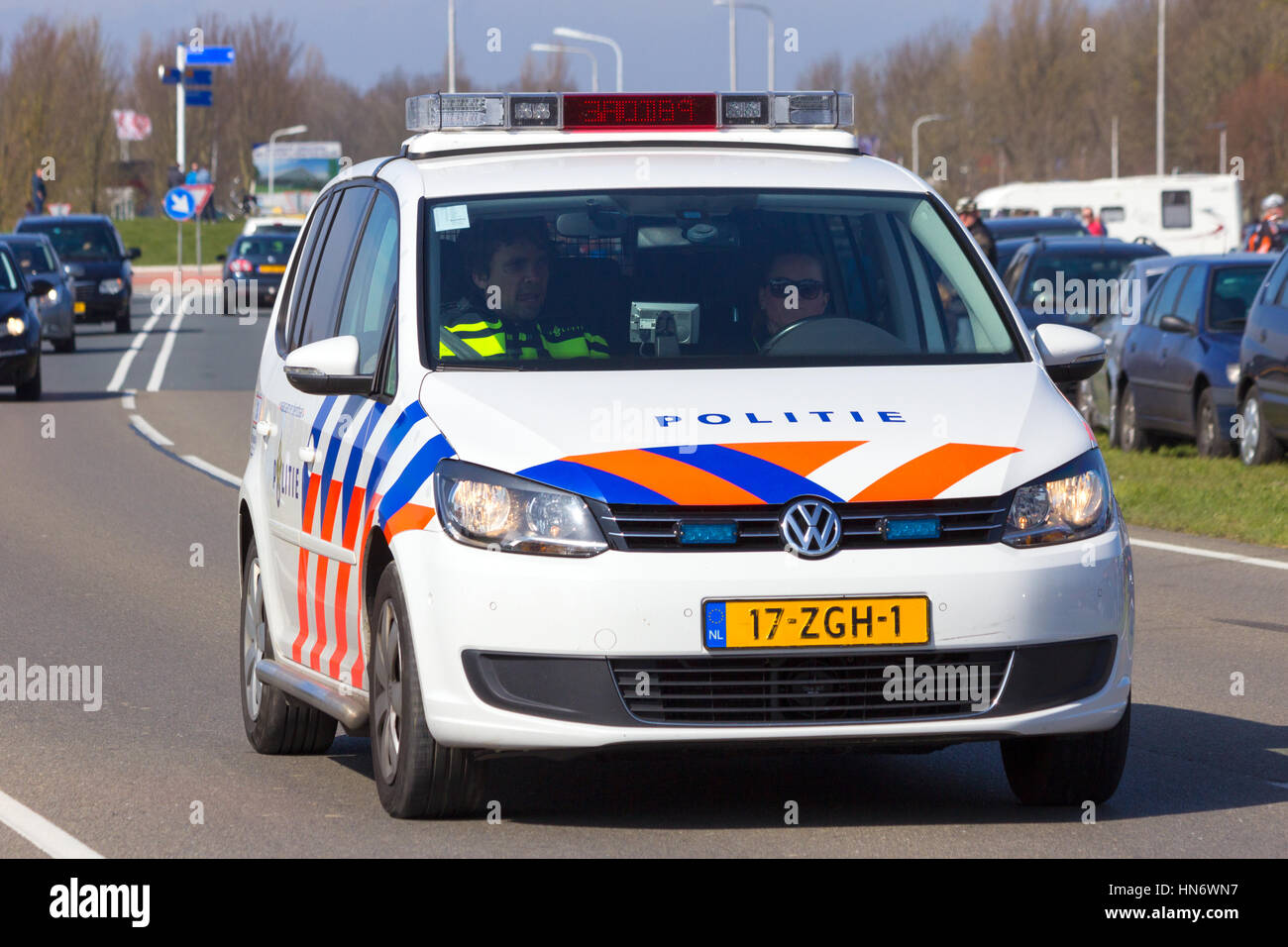 LEEUWARDEN, NETHERLANDS - 15 APRIL, 2015: A Dutch Volkswagen Touran on patrol. The police are the largest corporate - Stock Image