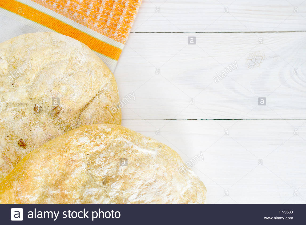 homemade ciabatta on a white wooden background - Stock Image