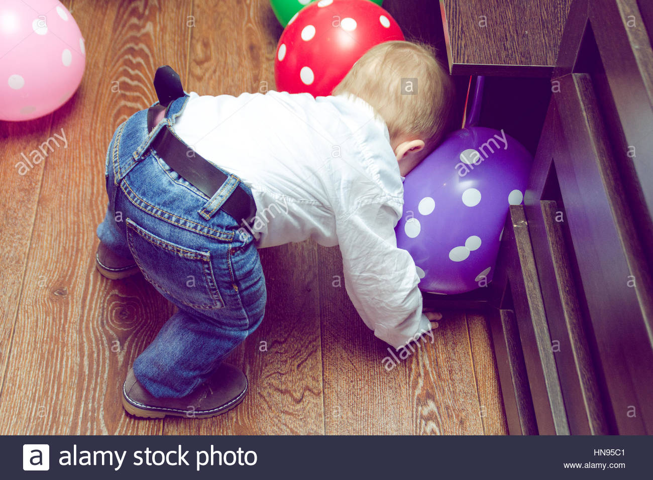 baby's first steps - Stock Image