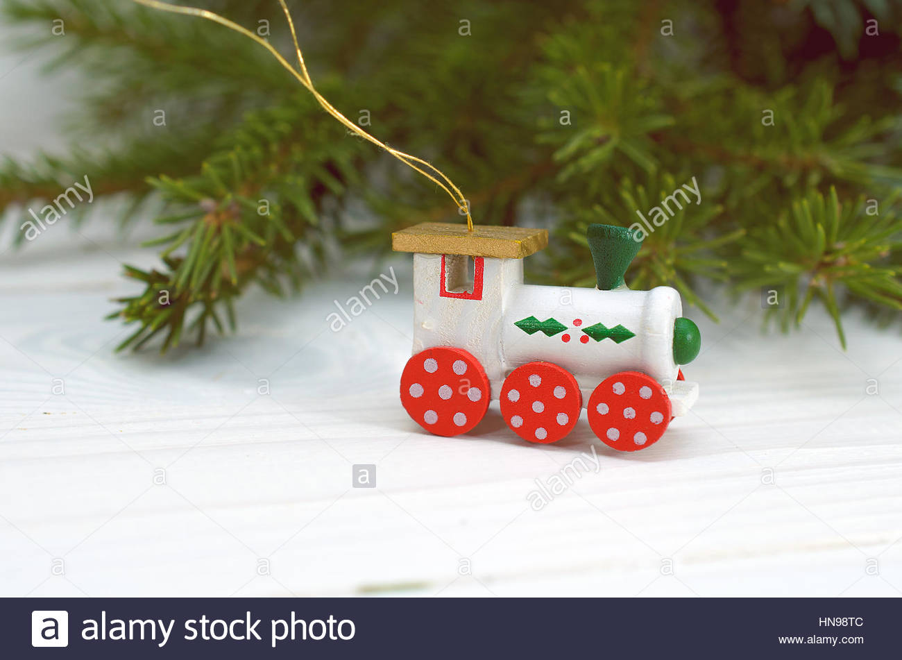 Pine Branches And Wooden Christmas Decorations On A White Background Stock Photo