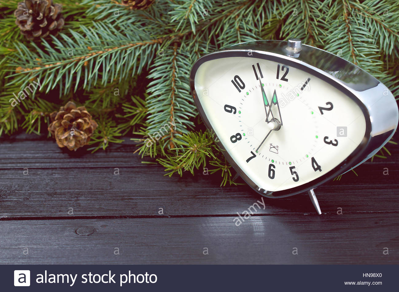 Watches And Pine Branches On A Dark Background In The New Year's Eve - Stock Image