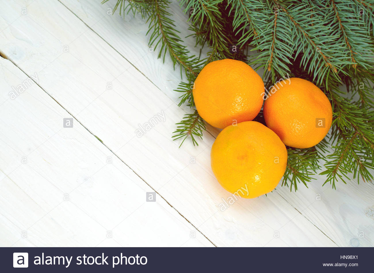 Pine Branches  And Tangerines On A White Background - Stock Image