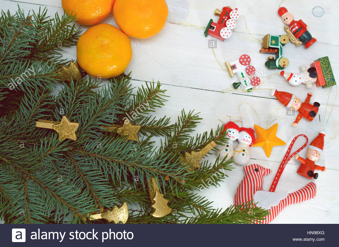 Pine Branches, Christmas Toys And Tangerines On A White Background - Stock Image