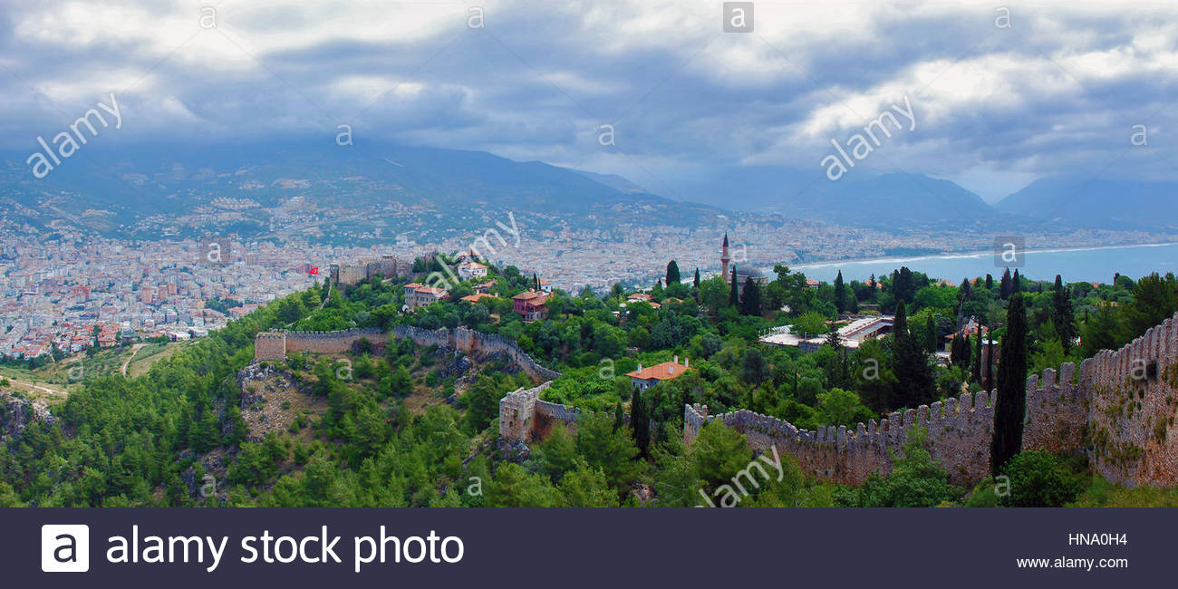 beautiful view of the sea, the mountains and the resort town in summer - Stock Image
