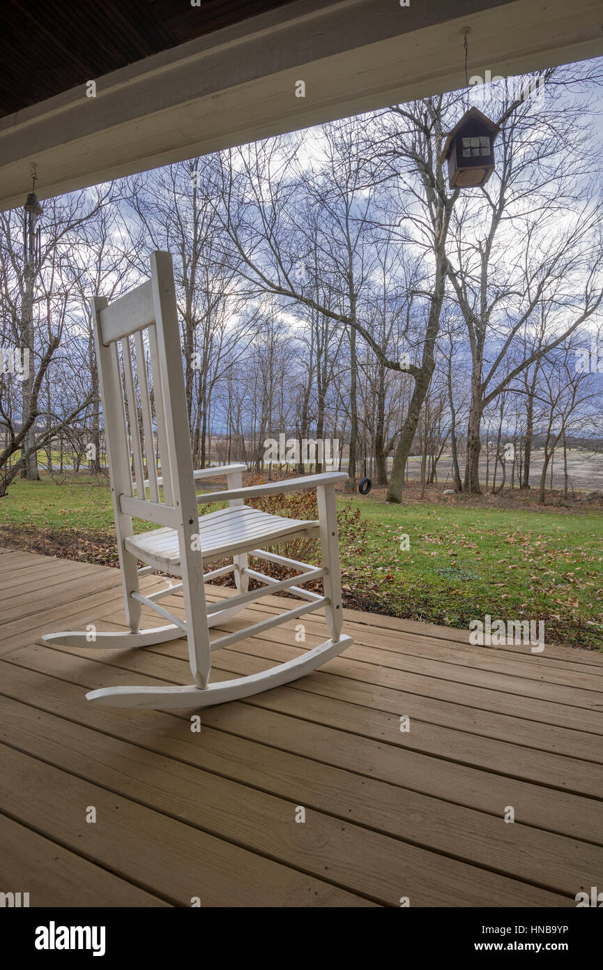 Retirement Rocking Chair On Rural Country Porch, Indiana USA - Stock Image